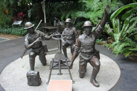 Bronze statue depicting three men of 1 Malay manning a field mortar