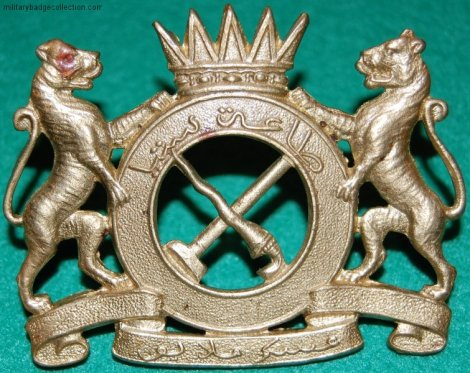 Cap badge of Malay Regiment: 'Taat Setia'