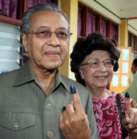 Fourth Prime Minister Tun Dr Mahathir Mohamad and Tun Dr Siti Hasmah Mohd. Ali voted in SK Titigajah