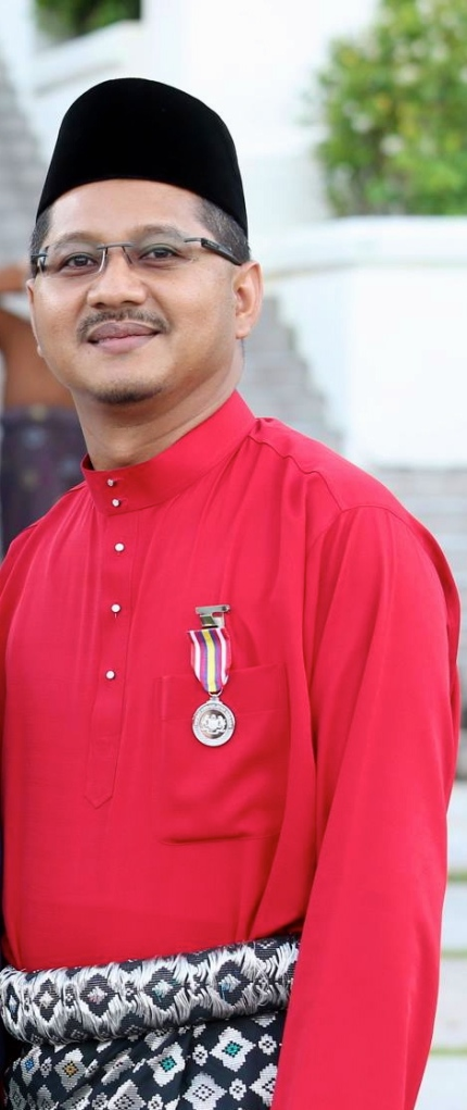 Dato' Akmal and his PKN medal, on Friday evening
