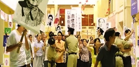 The provocative demonstration insulting the Malays scene in 'Tanda Putera'.