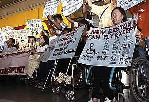 Wheelers and OKU protesting against AirAsia