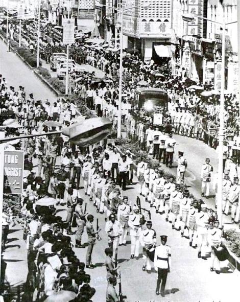 Funeral procession of notable Policeman of Chinese ethnicity Perak CPO tan Sri Khoo Chong Kong, assassinated in Ipoh on 13 Nov 1975 on his way to lunch