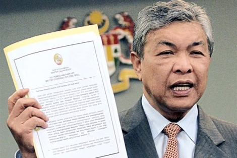 Document in hand: Dr Ahmad Zahid showing the press statement on the status of BOC holders during the press conference in Putrajaya.