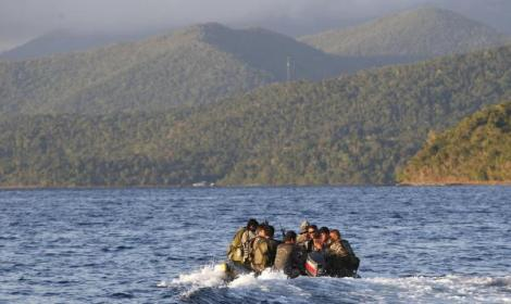 Members of the Philippine marines are transported on a rubber boat from a patrol ship after conducting a mission on the disputed Second Thomas Shoal, part of the Spratly Islands in the South China Sea, as they make their way to a naval forces camp in Palawan province, southwest Philippines March 31, 2014.