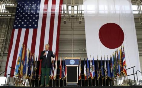 U.S. Defense Secretary Chuck Hagel speaks to U.S. and Japan military personnel stationed at Yokota Air Base on the outskirts of Tokyo April 5, 2014.