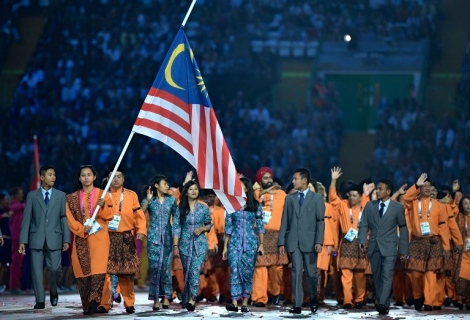 The brave athletes of the Malaysian Team Commonwealth Game 2014, demonstrating espirit de corp towards Malaysia Airlines and the nation in mourning, with the spirit of sportsmanship at the opening ceremony in Glasgow, Scotland