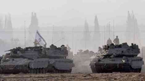 Israeli Merkava tanks prepared to push into densely populated districts in Gaza