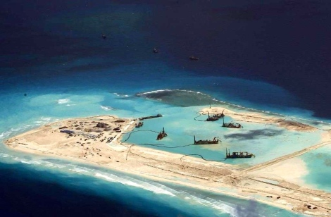 PLAN building a permanent airstrip and jetty in an atoll which was illegally occupied and contravened the UNCLOS