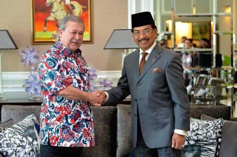 HRH Sultan of Johor handing over a personal donation of RM1million to Chief Minister of Sabah Musa Aman for the recent Kinabalu Earthquake Tragedy