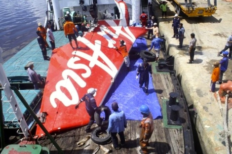 A section of AirAsia flight QZ8501's tail is loaded onto a boat for transportation to Jakarta from Kumai Port, where it had been stored since it was recovered last month, near Pangkalan Bun, Central Kalimantan 7 February 2015 in this file photo taken by Antara